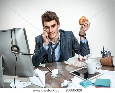 Modern Office Man Calling During His Breakfast At Working Place