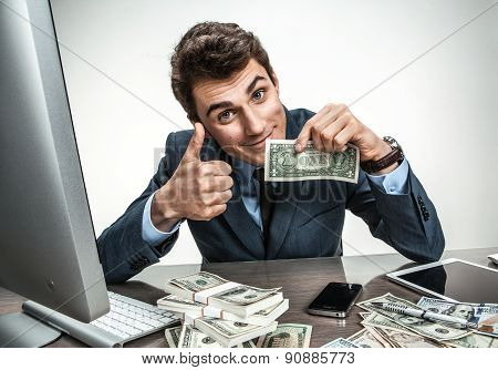 Cheerful Smiling Man Showing Thumbs Up Success Sign / Modern Businessman At His Desk With Computer A