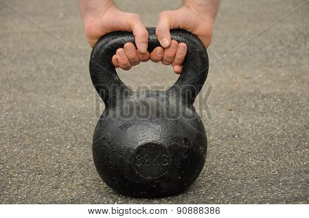 holding on to the kettlebell
