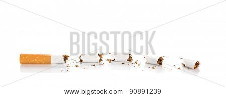 World No Tobacco Day : Broken cigarette isolated on white background