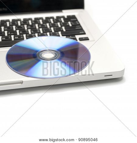 dvd dish on laptop isolated on white background poster