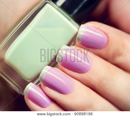 Nail Polish. Art Manicure. Nail Polish. Beauty hands. Trendy Stylish Colorful Nails and Nailpolish bottle closeup