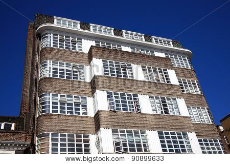 Art Deco residential apartment flats with a clear blue sky in Chelsea, London poster