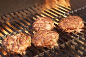 Minced Beef Pork Mutton Burgers On The Hot BBQ Grill Background Closeup. Good Snack For Outdoor Summer Barbecue Party Or Picnic poster