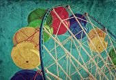 Vintage grunge background with colorful ferris wheel poster