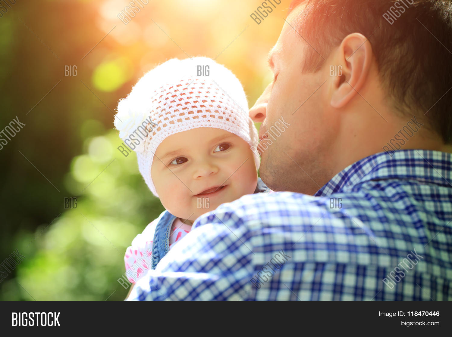 f7038a49d17 Father kissing and holding small daughter baby girl cute hazel-eyed kid  tiny little child