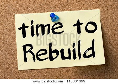Time To Rebuild - Adhesive Label Pinned On Bulletin Board