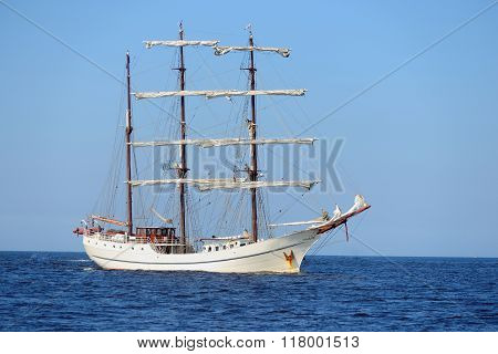 Old Historical Tall Ship With White Sails In Blue Sea poster