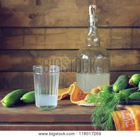 Still Life With Moonshine And Fresh Cucumbers.