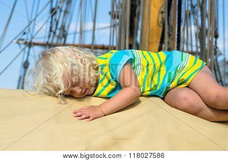Little Girl Fell Asleep On The Deck Of A Sailboat
