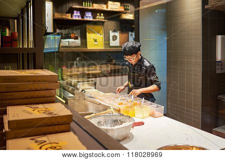 SHENZHEN, CHINA - JANUARY 26, 2015: La'Cesar pizzeria interior. La Cesar has captured diner's hearts with handmade durian pizza