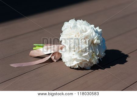Bridal bouquet on a brown background
