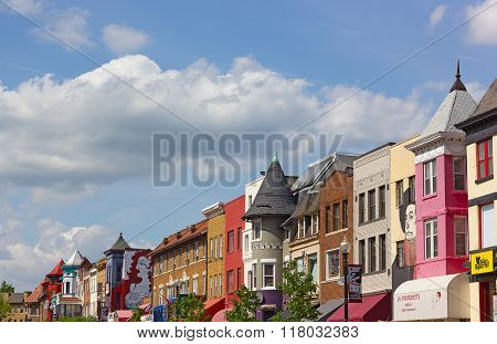 Sunny spring day on the street of a vibrant city neighborhood.