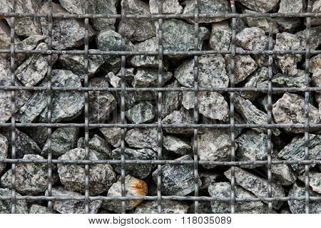 Stone paving stones of granite in a steel container