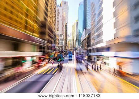 Hong Kong. Blurred Cityscape View With People Silhouettes At Zebra Crossroad