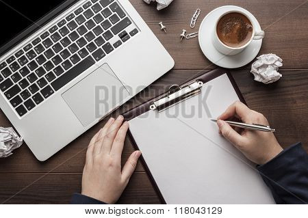 businesswoman at the office table with notepad and computer