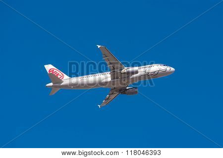 Airbus A 320 from Niki Airlines is taking off from Tenerife South airport