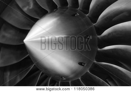 Close up view of an airplane turbine in black and white