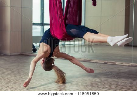 Aerial yoga practicing - anti gravity with scarves