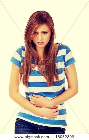 Teenage woman with stomach ache