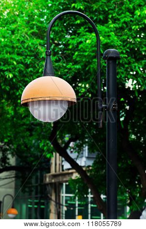 An old Thailand Orange streetlamp in a rural