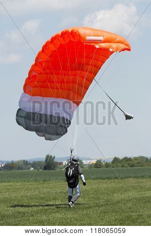 Parachutist Running After Landing In A Field