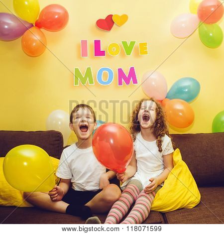 Happy laughing children congratulate his mother with a holiday. Happy Mother's Day concept.