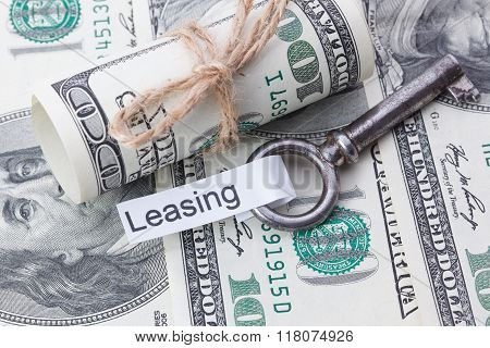 Money And Business Idea, The Dollar Bills Tied With A Rope, With A Sign On Key Fob - Leasing