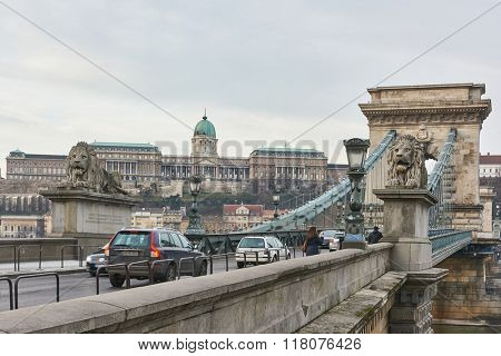 BUDAPEST, HUNGARY - FEBRUARY 02: Traffic over Szechenyi Chain Bridge with Buda Castle in the background. February 02, 2016 in Budapest.