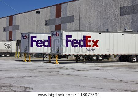 Indianapolis - Circa February 2016: Federal Express Trucks In Loading Docks VII