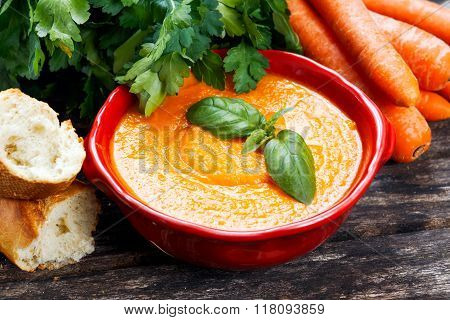 Carrot cream soup with vegetables