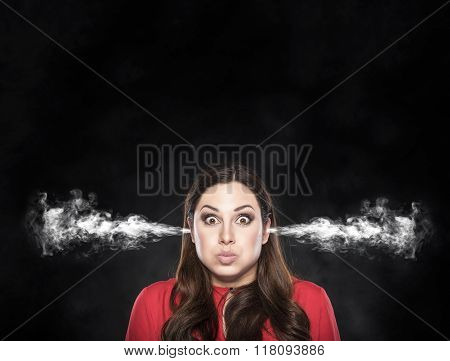 Smoke from the ears of a woman over dark background.