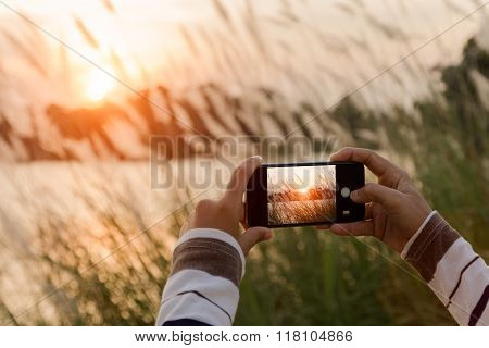 Closeup Hand Using Phone Taking Landscape Photo