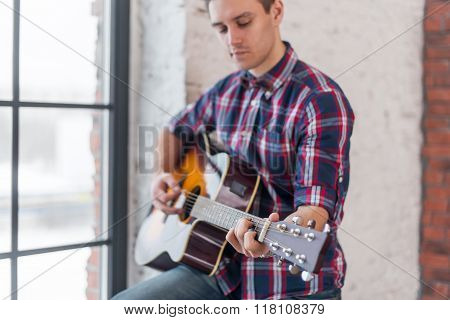 Man practicing in playing guitar focus on hand and chord