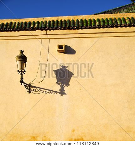 Street Lamp Old Construction In Africa Morocco And  Leather Near The Tower