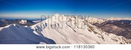 Winter mountains panorama with ski slopes. Caucasus panorama