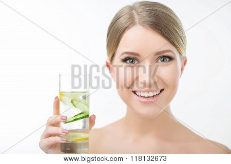 Pleasant woman holding glass of water