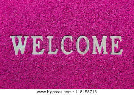 Welcome white mat isolated on pink background
