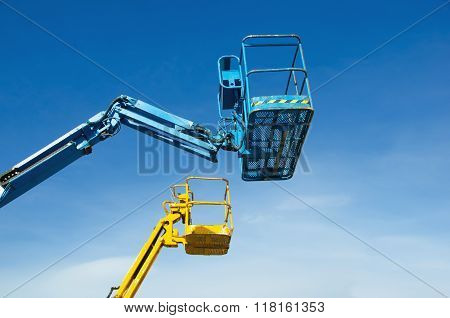 Two Crane's Baskets Against Clear Sky