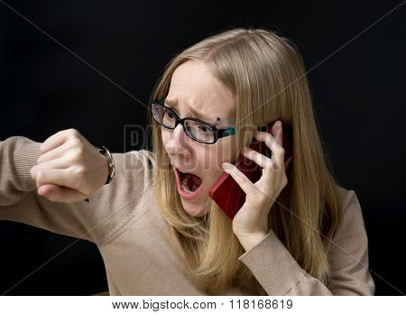 Closeup portrait anxious young girl with phone seeing bad news or photos with disgusting emotion on her face
