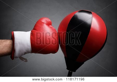 Punching a red punch bag concept for competition, challenge, conflict or leadership in business