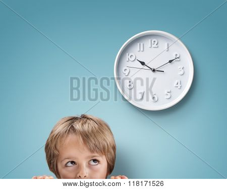Young boy looking up at a clock concept for deadline, anxiety and stress poster