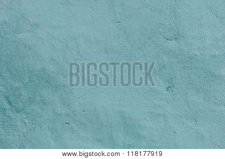 Grunge Background. Wall with the colored whitewash falling off fragment as a background texture