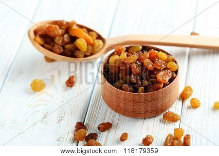 Dried Raisins On A Blue Wooden Table