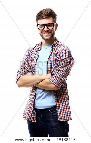 Latin hipster guy wearing glasses with his arms crossed and smiling on white background