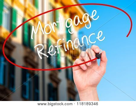 Man Hand Writing Mortgage Refinance With Black Marker On Visual Screen