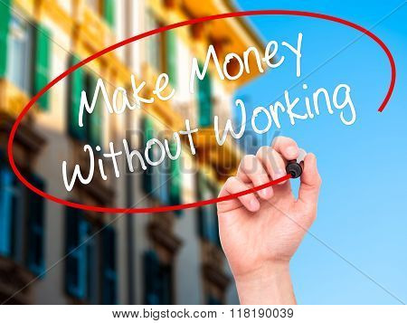Man Hand Writing Make Money Without Working With Black Marker On Visual Screen