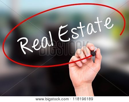 Man Hand Writing Real Estate  With Black Marker On Visual Screen
