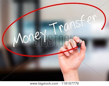 Man Hand Writing Money Transfer  With Black Marker On Visual Screen