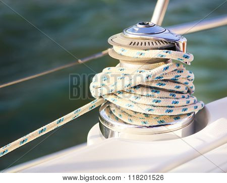 Sailboat Detailed Parts. Close Up On Winch And Rope Of Yacht Over Blue Sea